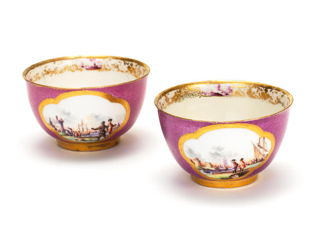 A pair of Meissen purple-ground teabowls and a Meissen purple-ground cup and saucer, circa 1735 and 1745