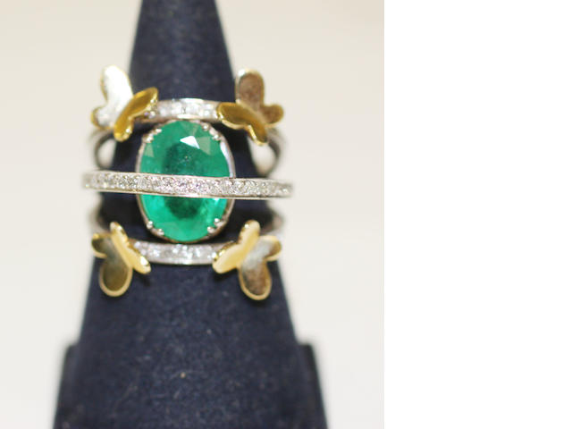 An emerald and diamond dress ring