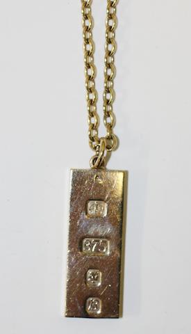 A 9ct gold ingot pendant (2)