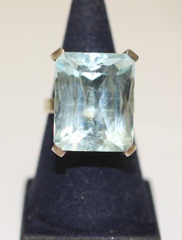 An aquamarine single stone ring