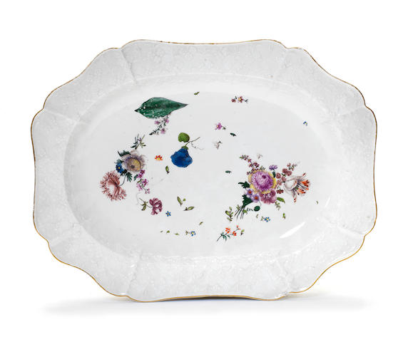 A set of eleven white Meissen plates and a large dish, circa 1750-55
