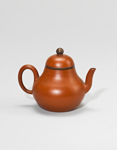 An Yixing stoneware teapot and cover Qing dynasty