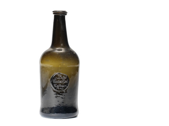 A sealed wine bottle, dated 1774