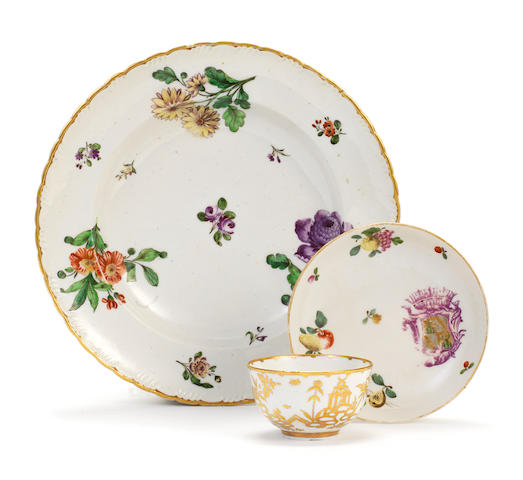A Cozzi armorial saucer, a Cozzi cup and a Cozzi plate, second quarter 18th century