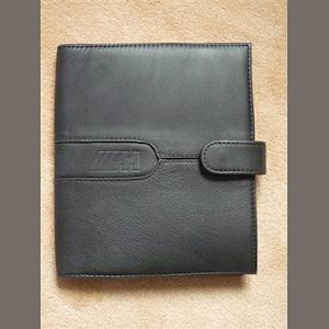 An original factory BMW M3 leather document pouch
