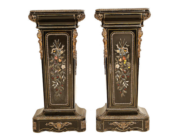 A pair of Napoleon III gilt metal and hardstone mounted, brass line inlaid, ebony and ebonised pedestal cabinets