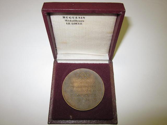 A 1948 St Moritz participants medal