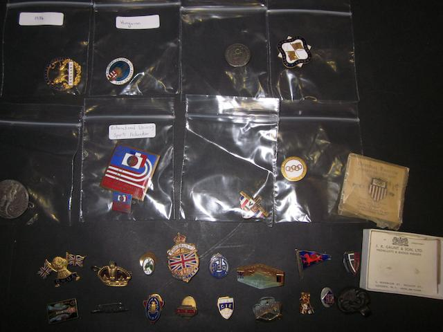 A collection of Olympic/Athletics pin badges