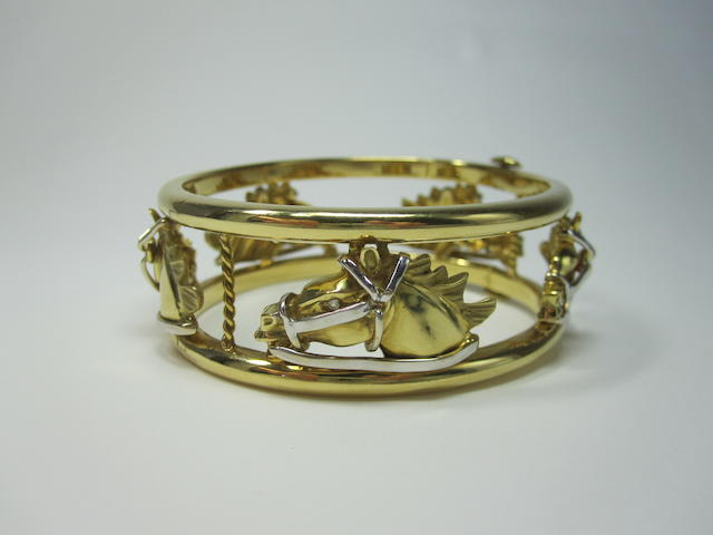 An 18ct two-colour gold diamond-set bangle