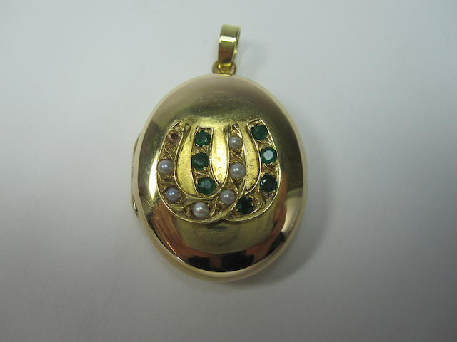 A late Victorian emerald and pearl horseshoe locket