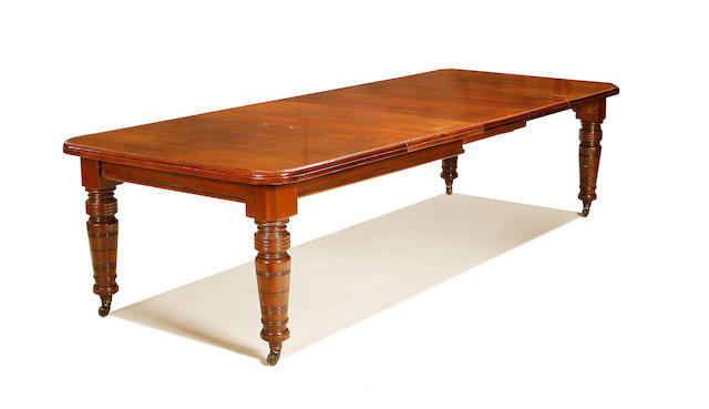 A late Victorian mahogany telescopic-action extending dining table