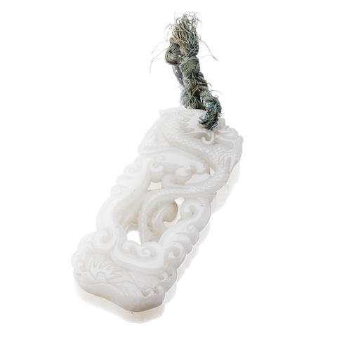 A white jade pendant  Qing