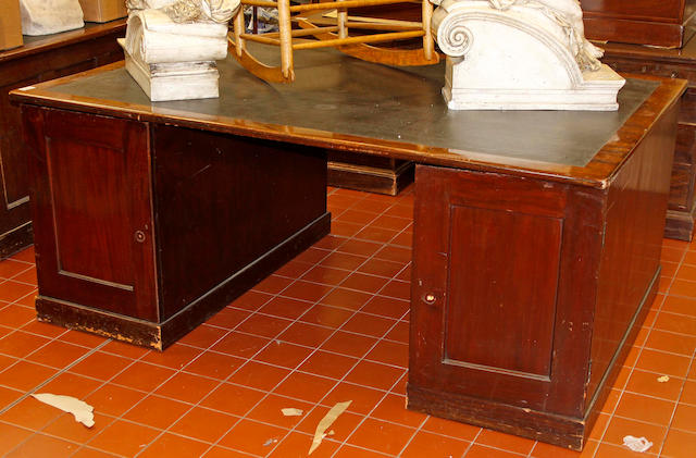 An early 20th century mahogany partners' desk,