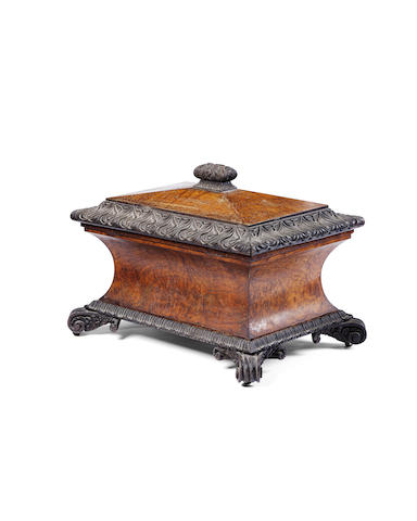 A large George IV burr oak sarcophagus-shaped wine cooler