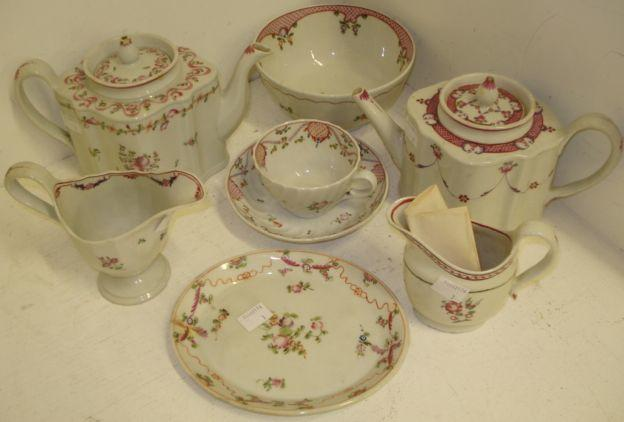 A Newhall teapot and cover, on four 'flower' feet, in a famille export pattern, another silver shape teapot and cover, in pattern 186, a Newhall helmet shape cream jug, 13cm, another oval shape 10.5cm, a circular slops bowl pattern 173, 15cm, damages, together with a spiral pattern cup and saucer oval teapot stand, pattern 195.
