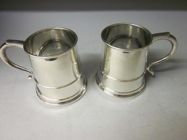 A pair of pint mugs, by Mappin and Webb, Birmingham 1946,  (2)