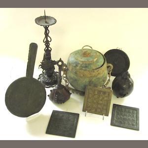 A small collection of bronze items