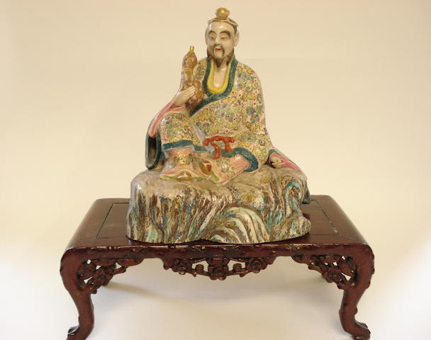 A Satsuma figure of a seated immortal Circa 1900