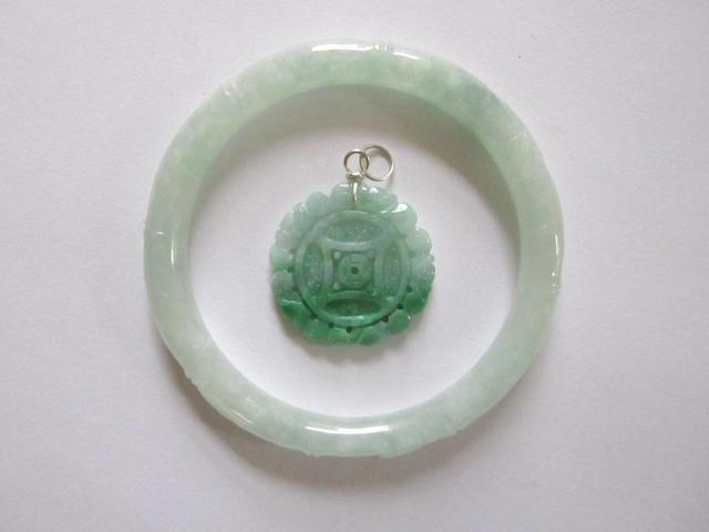 A jadeite bangle and pendant