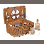 A veteran 'Coracle' two-person wicker-cased picnic set, by G W Scott & Sons, London,