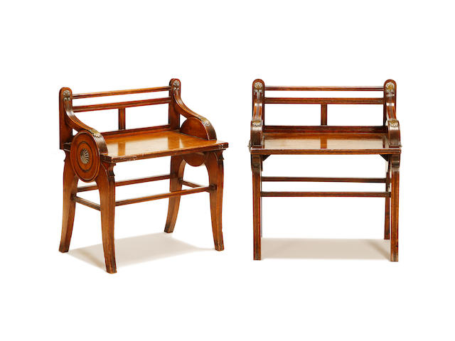 A pair of late Victorian oak and brass hall seats  by J.A.S. Shoolbred & Co.