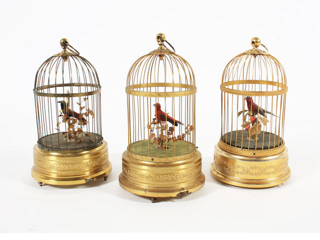 Three various single singing birds-in-cages: French and German makers, circa 1950,
