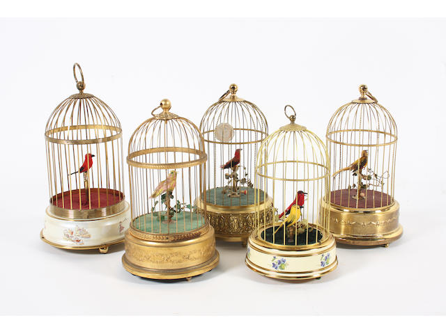 A collection of five singing birds-in-cages: by Reuge, Griesbaum and others, mid 20th century,