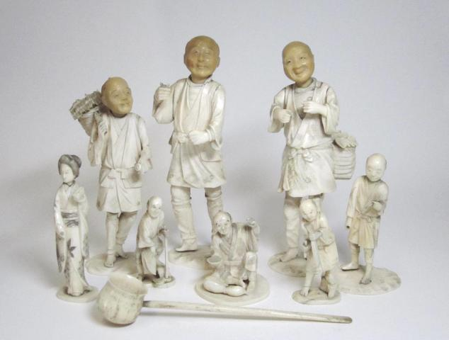 Eight carved ivory figures and a ladle