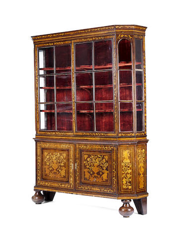 A 19th century Dutch walnut and marquetry breakfront display cabinet