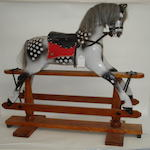 A carved wooden Harrods rocking horse