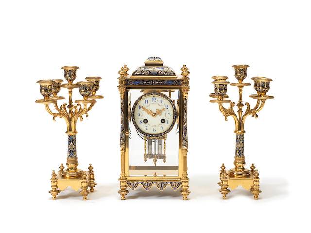 An early 20th century French gilt brass and champleve enamel clock garniture H&H