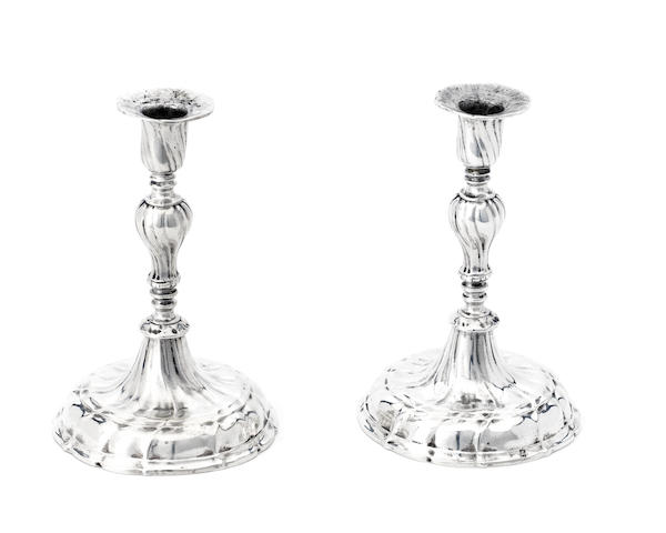 A pair of 18th century Continental silver candlesticks, stamped with crowned A and other misstruck marks,