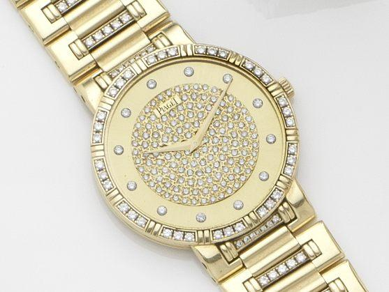 Piaget. An 18ct gold diamond set quartz bracelet watchRef:84024 N K 818, Case No.647410, Movement No.0100126, Circa 1990's
