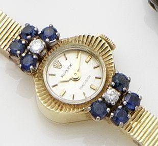 Rolex. An 18ct gold diamond and sapphire set lady's manual wind bracelet watch Ref:9653, Case No.670990, Circa 1960's