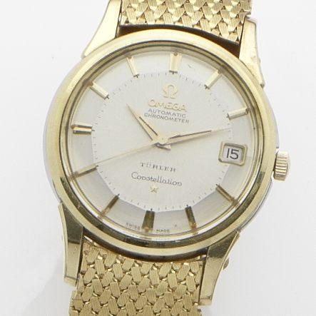 Omega. A gold plated calendar automatic bracelet watch Constellation, Retailed by Turler, Case No.14393 10 SC, Movement No.17727471, Circa 1960