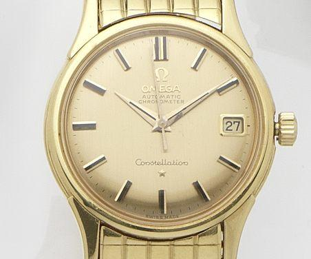 Omega. An 18ct gold calendar automatic bracelet watchConstellation, Ref:14393/4 SC 10, Case No.484300, Movement No.17456450, 1960's