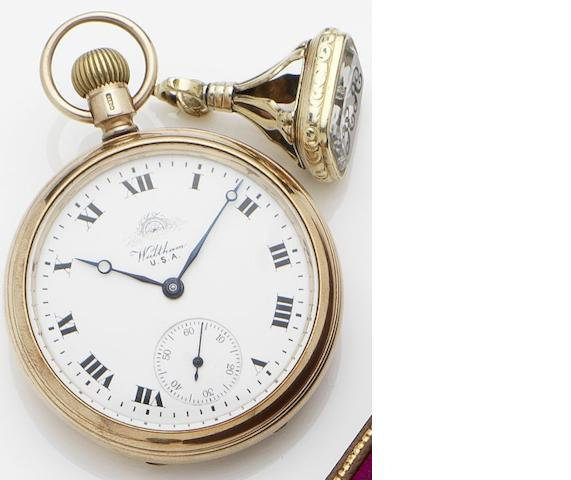Waltham. A 9ct gold open faced keyless wind pocket watch with earlier associated continental gold and rock crystal fob Case No.1372, Movement No.21774947, Chester Hallmark for 1920