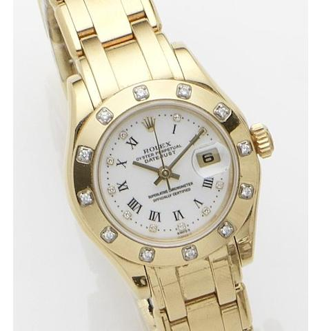 Rolex. An 18ct gold and diamond set calendar automatic bracelet watch  Datejust, Ref:80318, Case No.A661614, Movement No.0276081, Sold on 21st March 2001