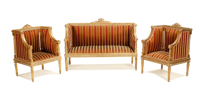 An early 20th century giltwood salon suite in the Louis XVI style