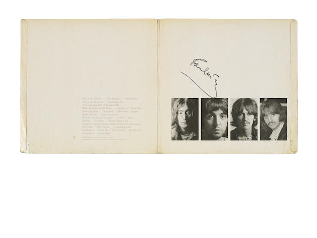 An original pressing of the 'White Album' autographed by Paul McCartney,