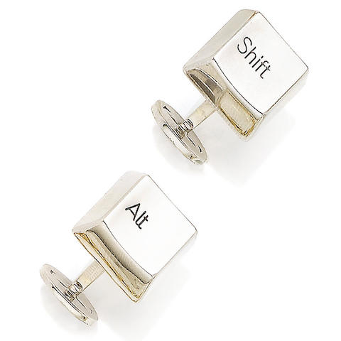 A pair of white gold cufflinks, by Cartier