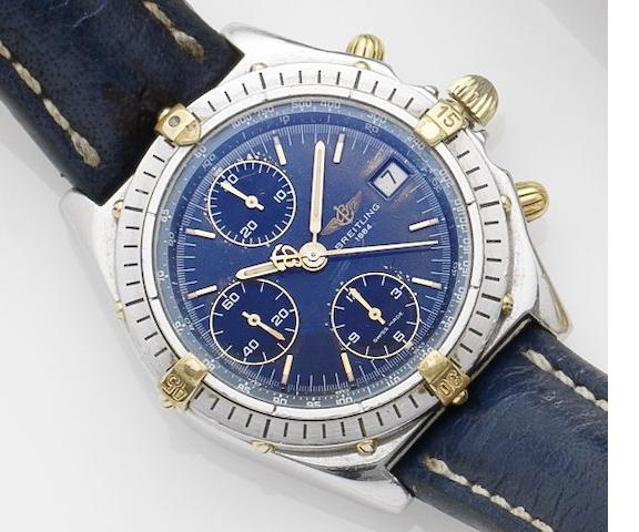Breitling. A stainless steel and gold calender chronograph watch