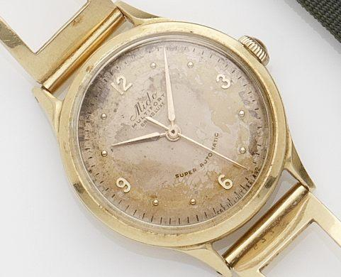 Mido. An 18ct gold bracelet watchCase No.1255774, Circa 1950