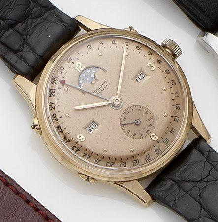 Record. An 18ct rose gold triple date manual wind wristwatch with moon phases Case No.733526/1121, Circa 1950's