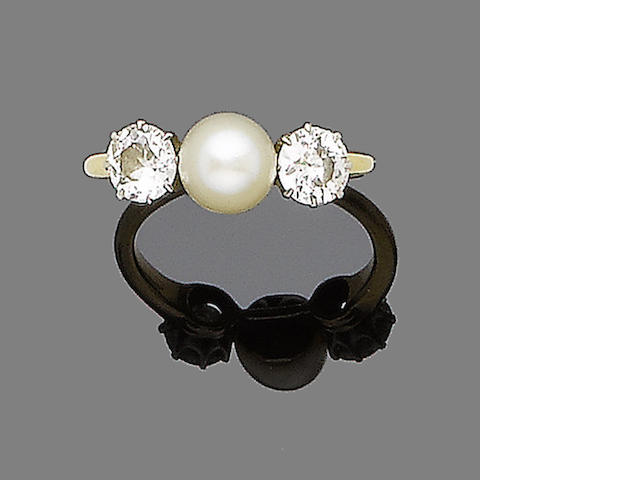 A pearl and diamond three-stone ring