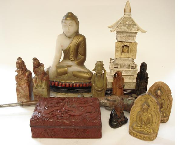 A collection of stone and other carvings
