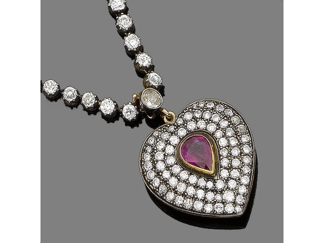 A diamond rivière with a ruby and diamond pendant