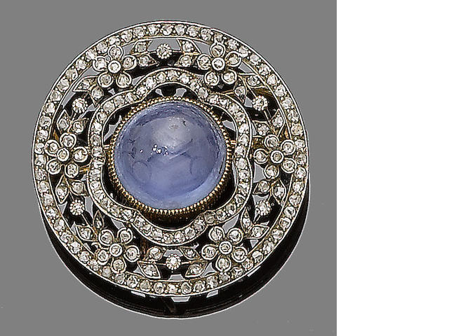 A star sapphire and diamond pendant/brooch