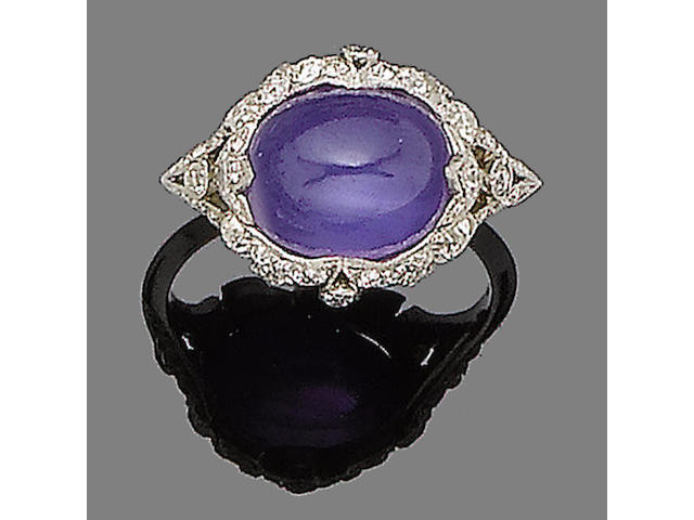 A purple star sapphire and diamond ring