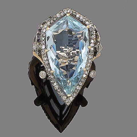 An aquamarine and diamond dress ring
